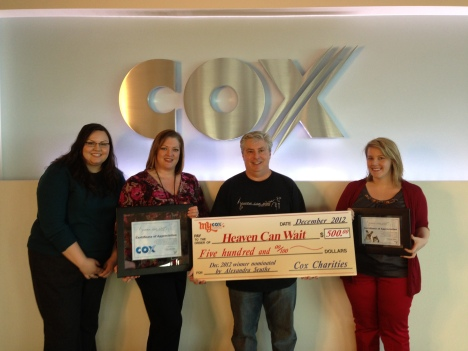 Employees with Cox Communications award HCWS President, Harold Vosko with donation.