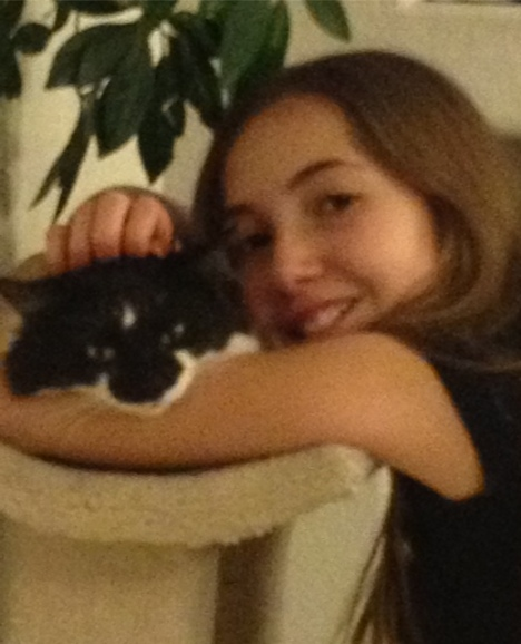 HCWS Youth Group member Sage (pictured with her cat, Tippie) designed jewelry to help the cats and dogs in our care.
